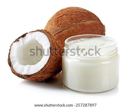 coconut oil and fresh coconuts isolated on white - stock photo