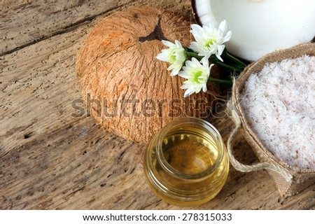 Coconut oil, essential oil from nature, a skin care that safe, rich vitamin, use in massage at spa, organic cosmetic on wooden background - stock photo
