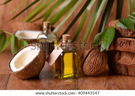 coconut oil in the bottle with fruits around - stock photo
