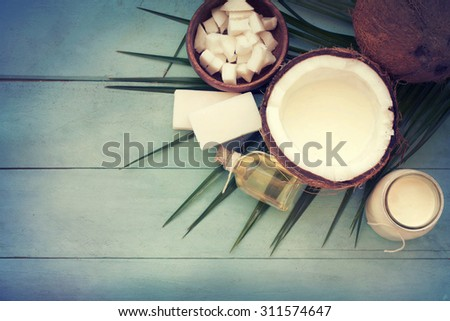 Coconut oil on table - stock photo