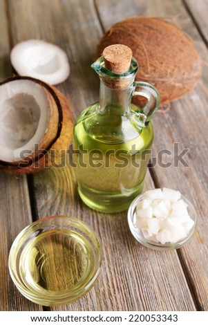 Coconut oil on table close-up - stock photo