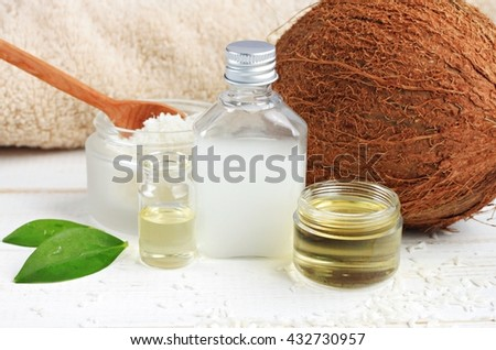 Coconut oil products cosmetic use. Skincare benefits. Bottles coconut oil, coconut milk, shavings. - stock photo