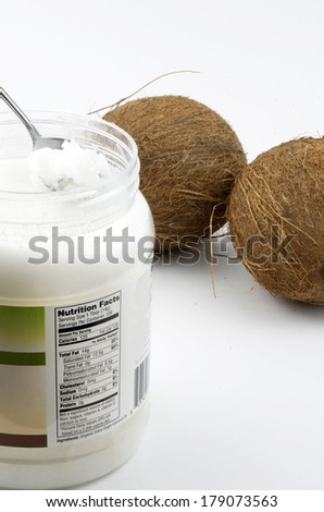 Coconut Oil With Coconuts - stock photo