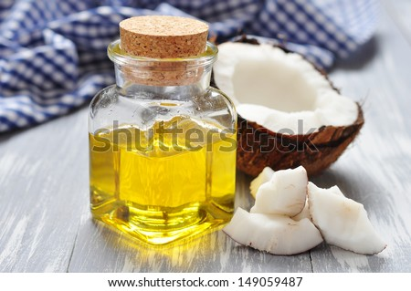 Coconut oil with fresh coconut for alternative therapy - stock photo