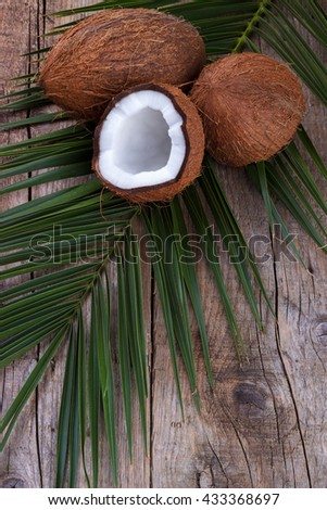 Coconut on wooden table.Organic healthy food concept. - stock photo