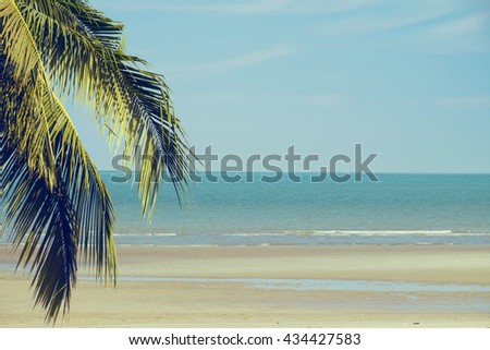 Coconut palm on the beauty beach, Beach on the tropical island - Vintage Filter - stock photo