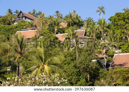 Coconut palm trees and bungalows on Koh Samui, Thailand - stock photo