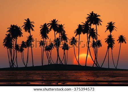 coconut palms at orange tropical sunset over calm sea - stock photo
