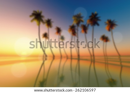 coconut palms at tropical sunset blurred background - stock photo