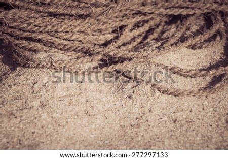 Coconut rope on  sand close up. Retro style effect - stock photo