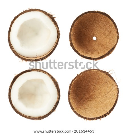 Coconut sliced in halves both with and without the coconut meat isolated over the white background - stock photo