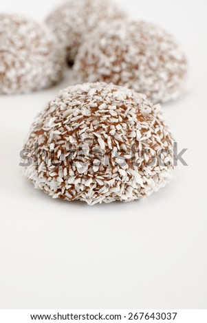 Coconut snowballs a marshmallow confection covered in chocolate and dessicated coconut - stock photo