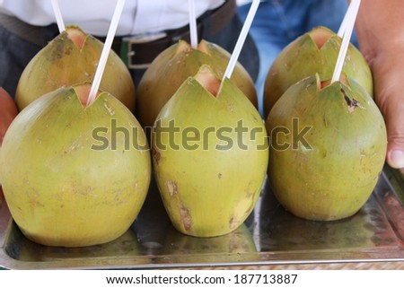 Coconut water in a coconut - stock photo