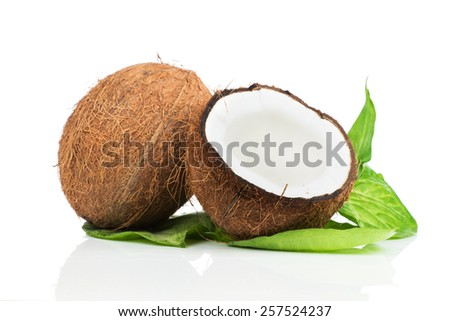 Coconut with green leaves on white background - stock photo