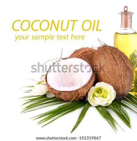 Coconuts and coconut oil, isolated on white - stock photo