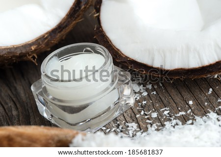 Coconuts and organic coconut oil in a jar.  Beauty and cuisine. - stock photo