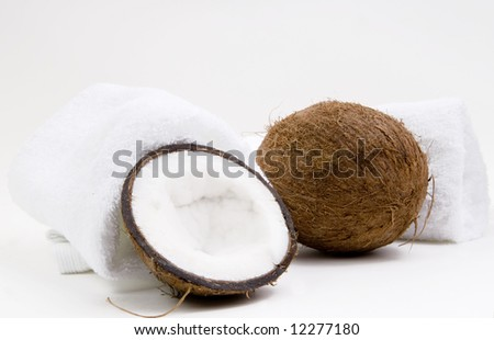 Coconuts and white towels on white background - stock photo
