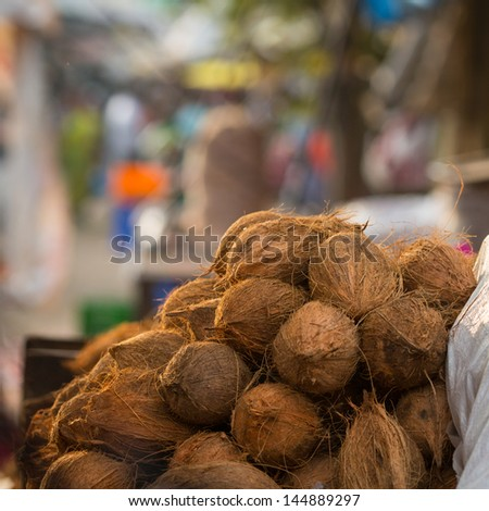Coconuts in the Indian market - stock photo