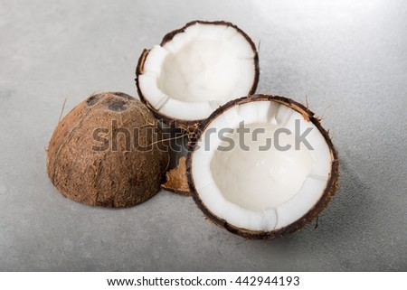 Coconuts shells on grey background - stock photo