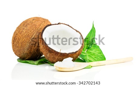 Coconuts with green leaf and wooden spoon - stock photo