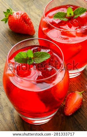 Coctail. Refreshing summer drink with Strawberry in two glasses on rustic wooden table - stock photo