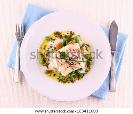 Cod Fillet with green beans, peas, parsley, olive oil, top view - stock photo