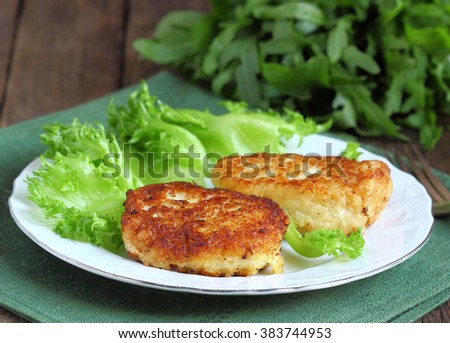 Cod fish cakes served with a salad. - stock photo