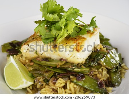 Cod Fish Fillets With Rice and Peas - stock photo