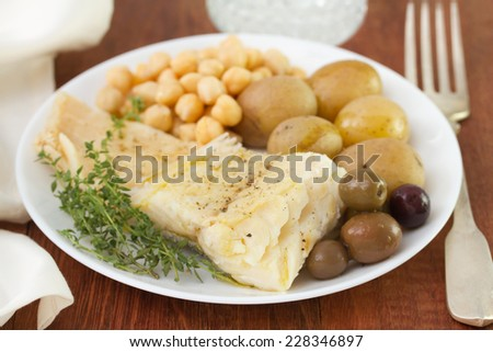 cod fish with chickpea and potato - stock photo