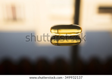 Cod liver fish oil omega 3, 6 and 9 capsule health food supplement. - stock photo
