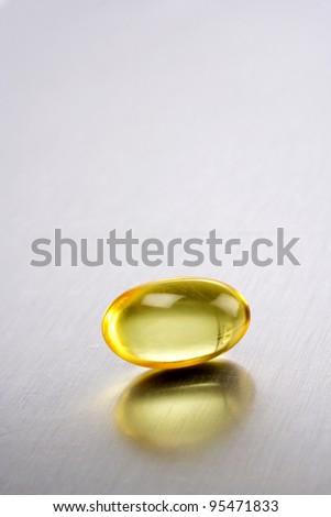 Cod liver oil pill - stock photo
