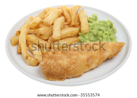 Cod with chips and mushy peas. Focus on the fish. - stock photo