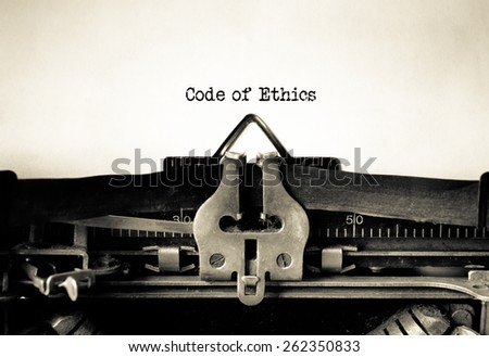 Code of Ethics and Conduct typed on vintage typewriter - stock photo