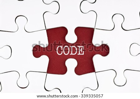 Code Text on Puzzle on the Place of Red Missing Pieces Background - programming and software concept - stock photo