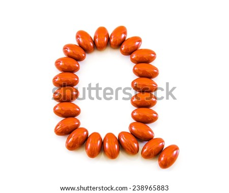 coenzyme q10 supplement capsules closeup on a white background - stock photo