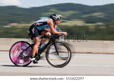 COEUR D ALENE, ID - JUNE 23: Natasha van der Merwe on bike at the June 23, 2013 Ironman Triathlon in Coeur d'Alene, Idaho. - stock photo