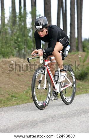 COEUR D'ALENE, IDAHO, JUNE 21: Triathlete  Caroline Steffen of Switzerland on the bike portion of the Coeur d'Alene Ironman Triathlon in northern Idaho on June 21, 2009, - stock photo