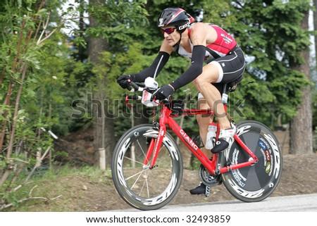 COEUR D'ALENE, IDAHO, JUNE 21: Triathlete James Bonney of Austin, TX on the bike portion of the Coeur d'Alene Ironman Triathlon in northern Idaho on June 21, 2009, - stock photo