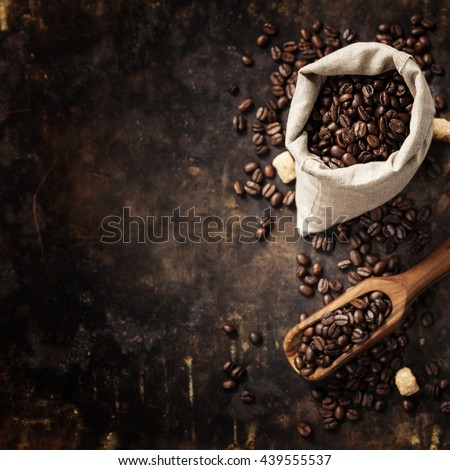Coffe composition on dark rustic background with space for text - stock photo