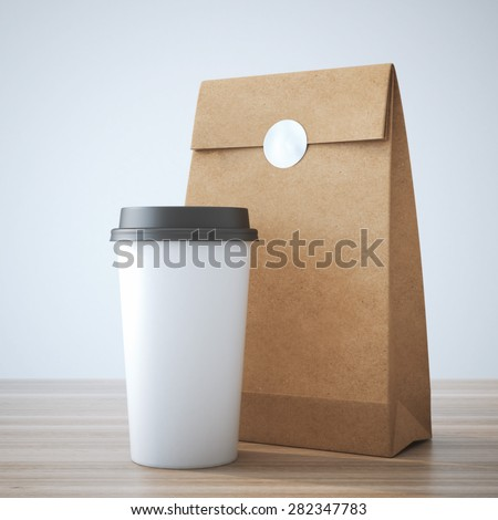 Coffe cup and paper bag - stock photo