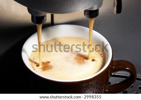 coffe dispenser with cup of coffee - stock photo