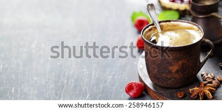 Coffe with Fruit dessert on dark background - stock photo
