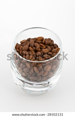 coffea beans in glass on white background - stock photo