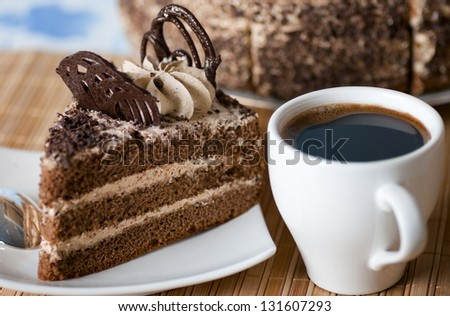 coffee ,a slice of cake on the plate on the background of cake - stock photo