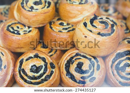 coffee and bakery shop bar with tasty fresh baked cinnamon raisins rolls  - stock photo