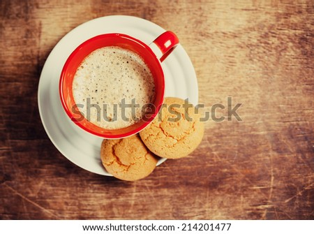 Coffee and biscuits on wooden board - stock photo