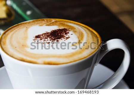Coffee and cheesecake on brown table - stock photo