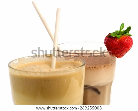 Coffee and chocolate frappe, decorated with strawberry - stock photo