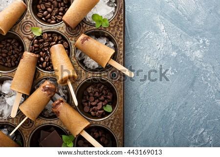 Coffee and cream popsicles with Irish cream and chocolate fudge - stock photo