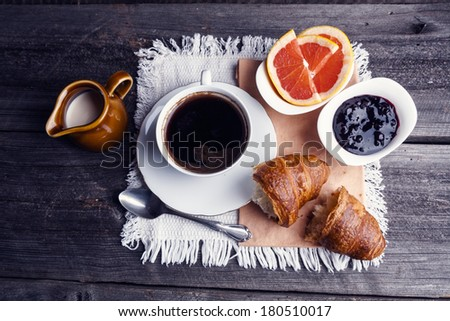 coffee and croissant.  - stock photo